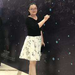Shuang Zhang writing on a blackboard